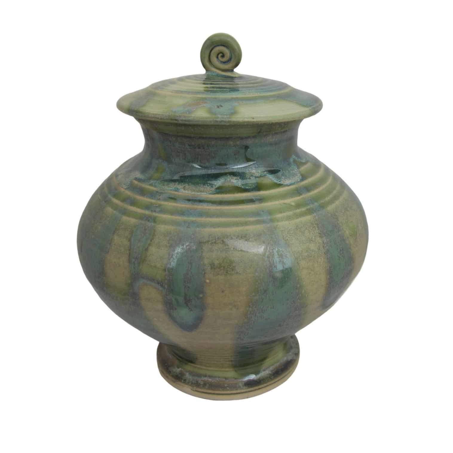 boann cremation urn in fern green with wide centre and spiral detailing on the lid