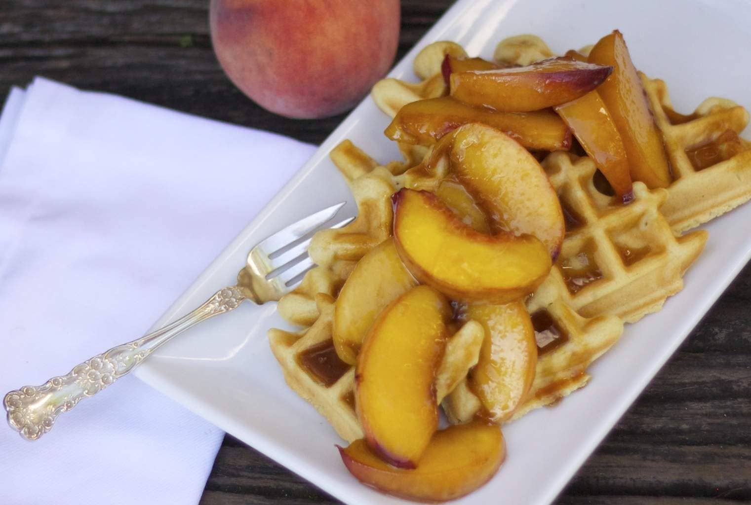 Waffles topped with Peaches and Fork