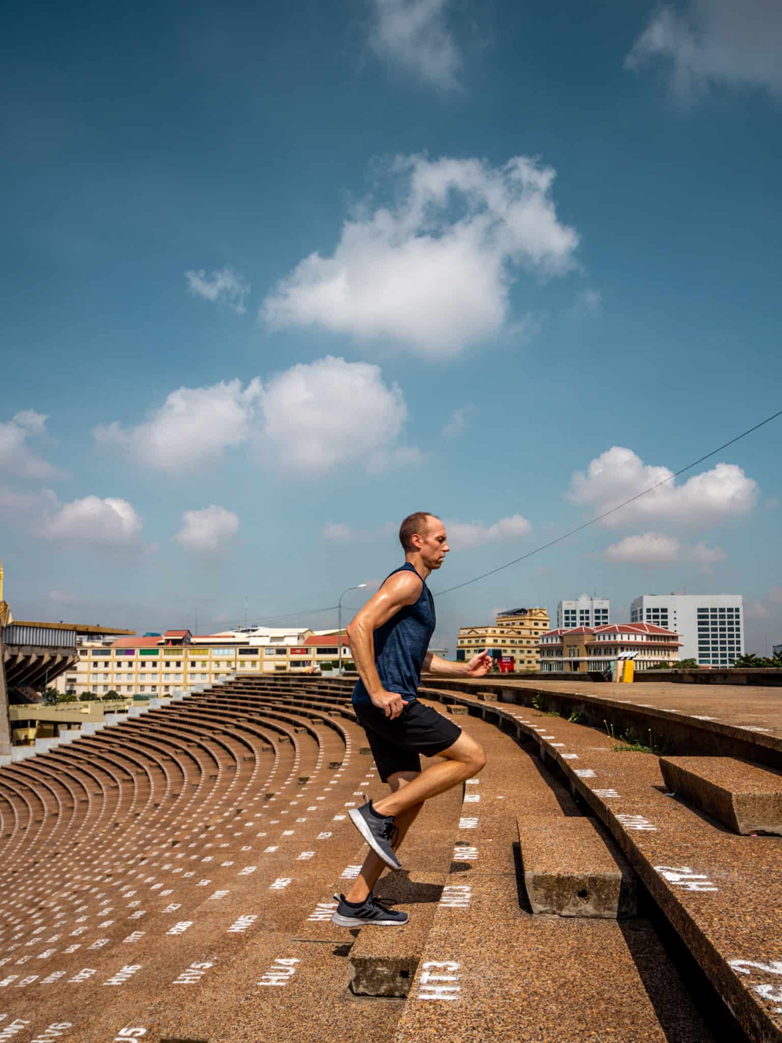 Nate running up steps at Olympic Stadium - Decathalon Gear