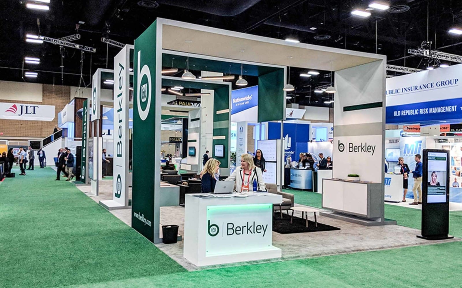 green booth with meeting area under arches for berkley