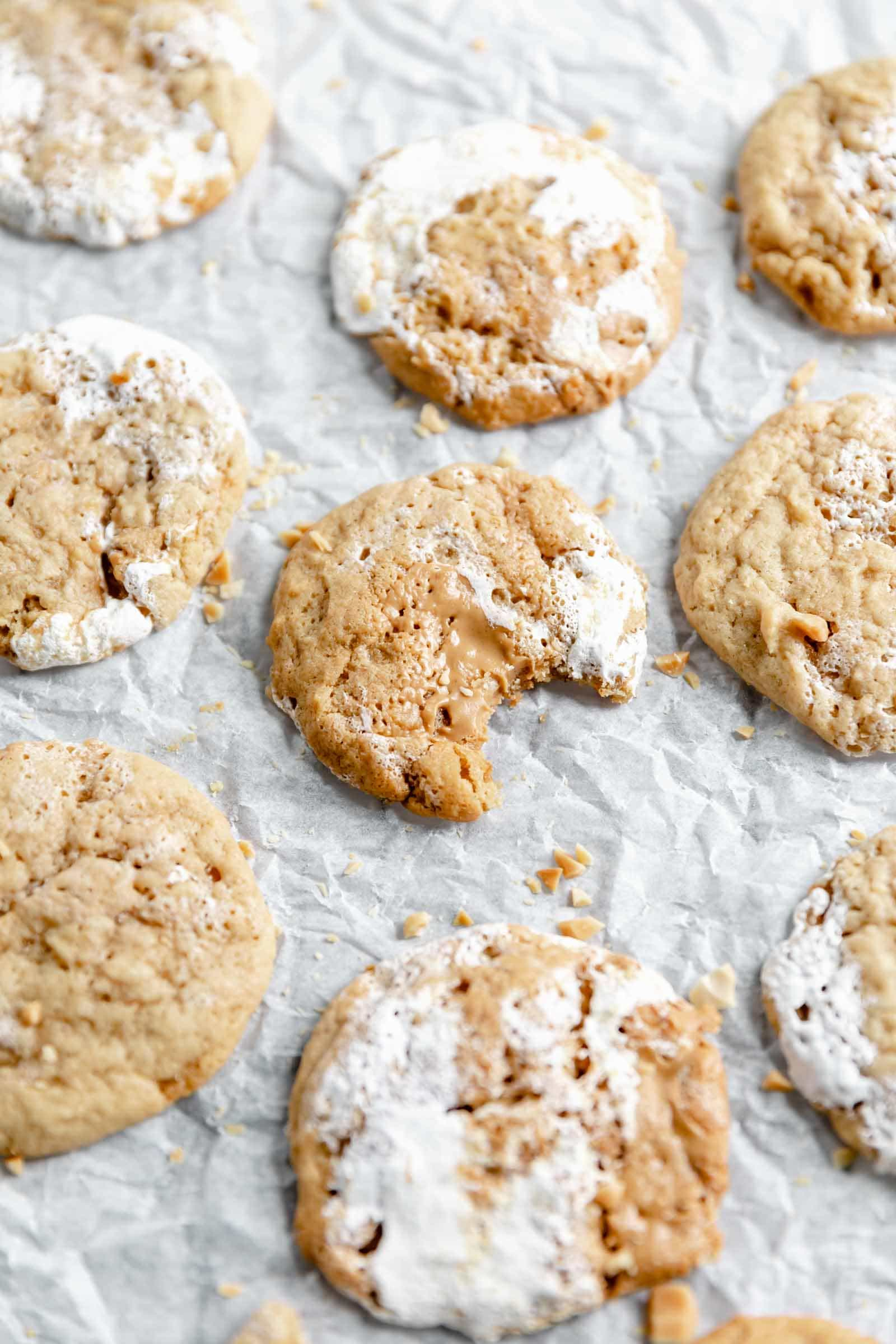 peanut butter and fluff cookies with a bite taken out