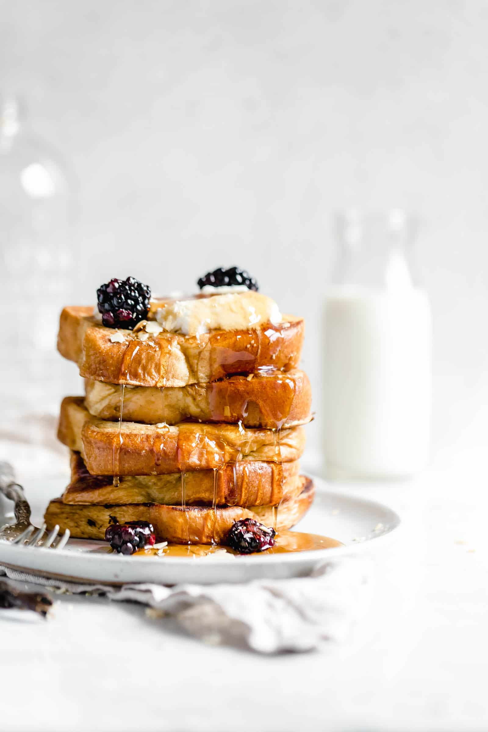 stack of bourbon vanilla french toast with glass of milk