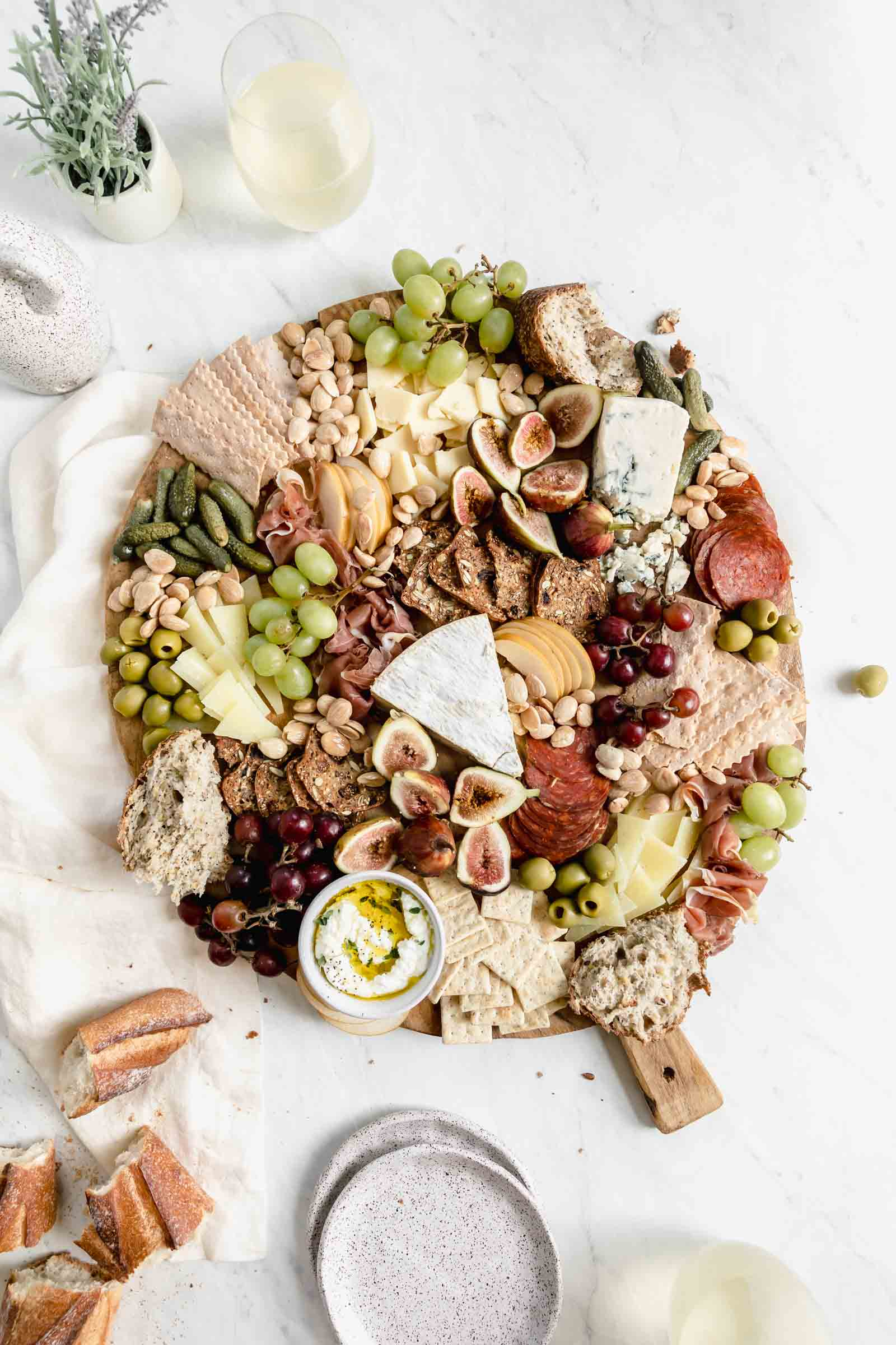 fill in cheese board gaps with marcona almonds to complete cheeseboard