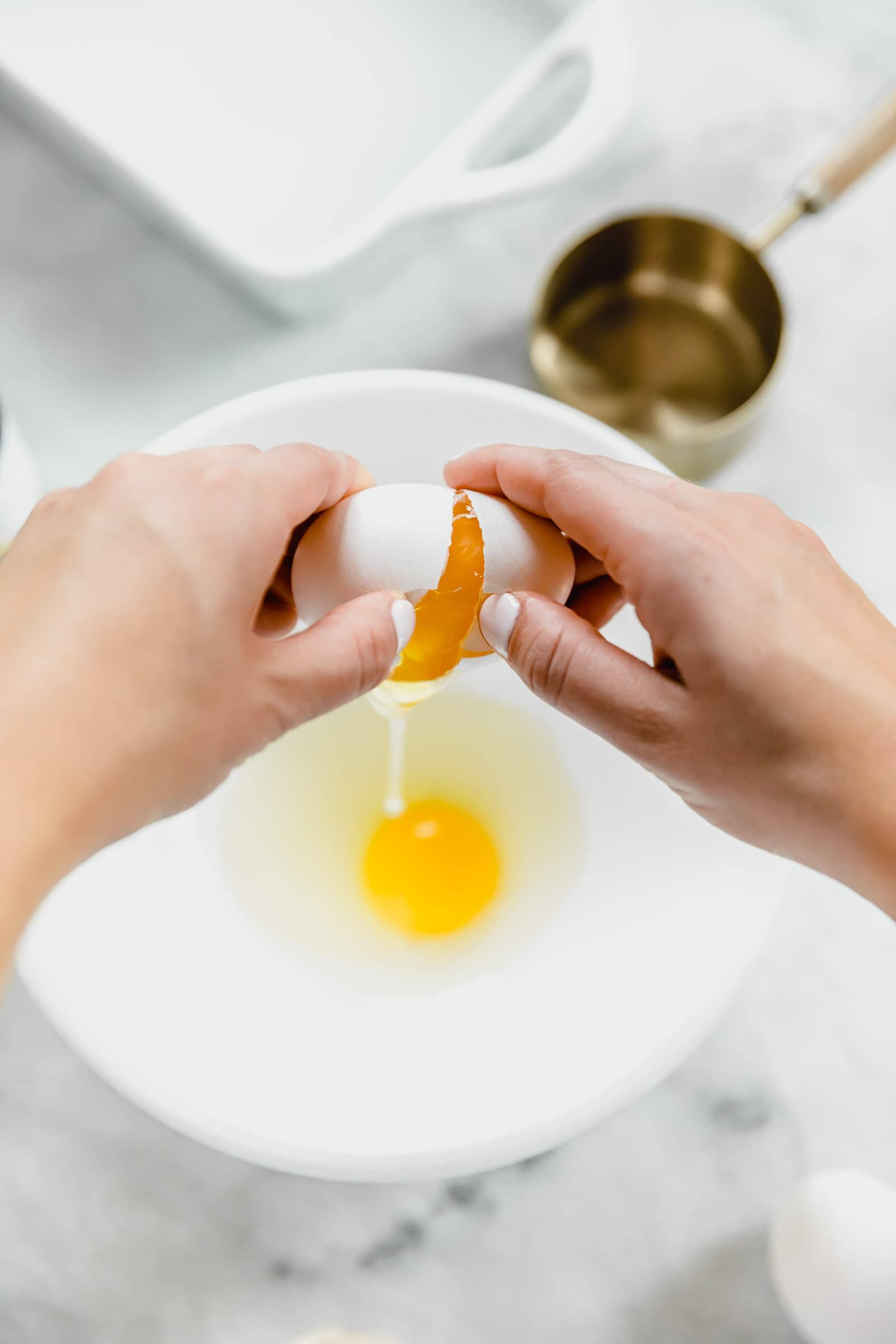 egg being cracked into bowl