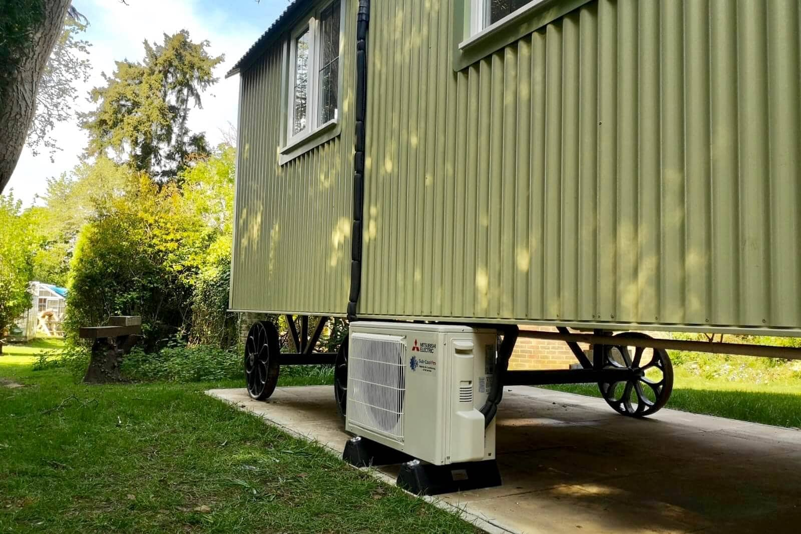 White mitsubishi air conditioning external unit shepherds hut SubCool FM