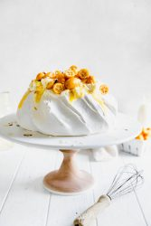 Make everyone say HUBBA HUBBA with this showstopping white chocolate and lemon curd pavlova topped with baby kumquats and sliced almonds.