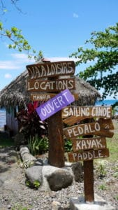 Painted directional street signs in Moorea