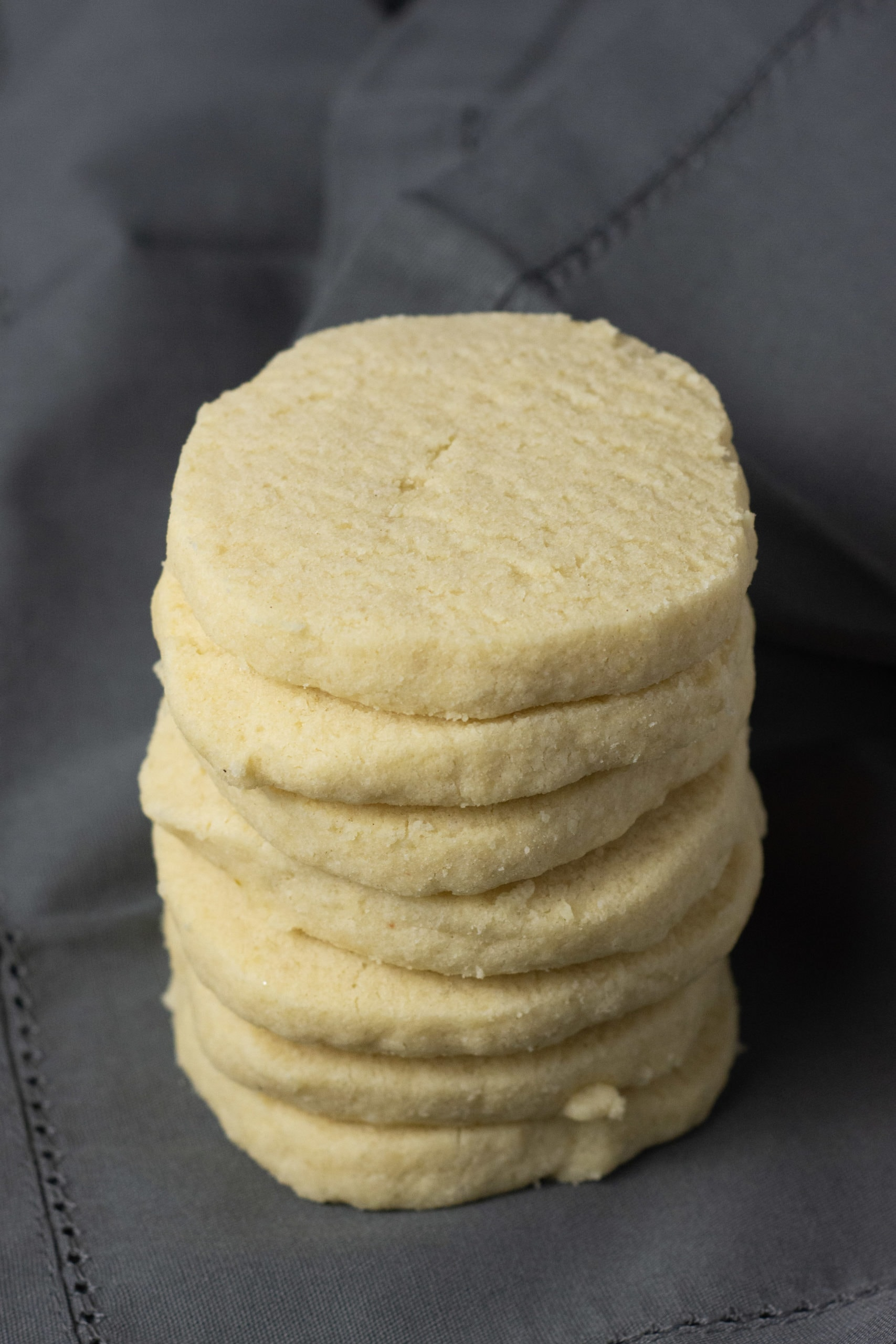 a stack of shortbread cookies on a grey background
