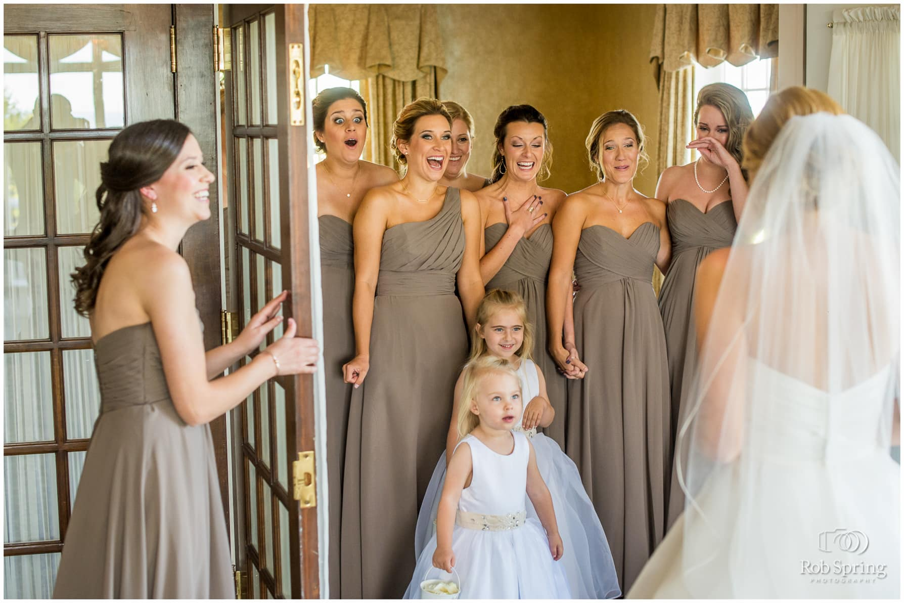 Bridesmaids and flower girls reveal, crying, emotional wedding moment. Albany Country Club Wedding photographers