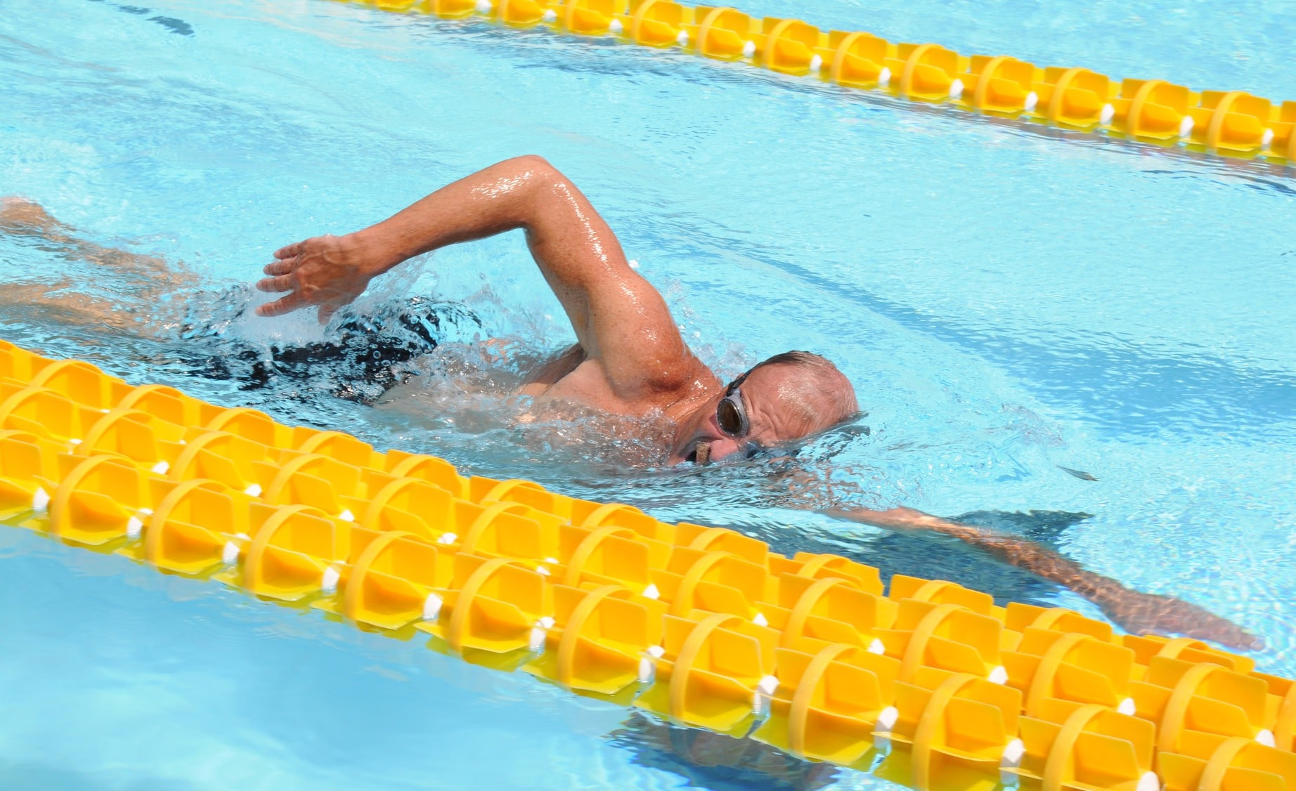 aquatic therapy, spine - person swimming in a lane