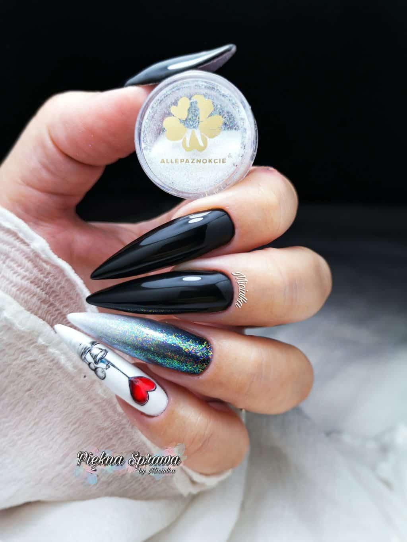 czarny manicure hybrydowy z efektem białego pyłku