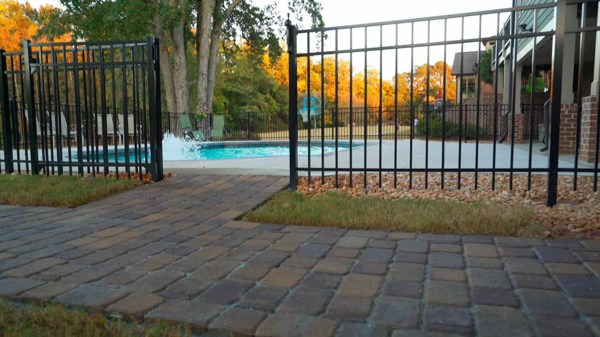 Paver walkway to a pool is a simple DIY project to connect your backyard spaces.
