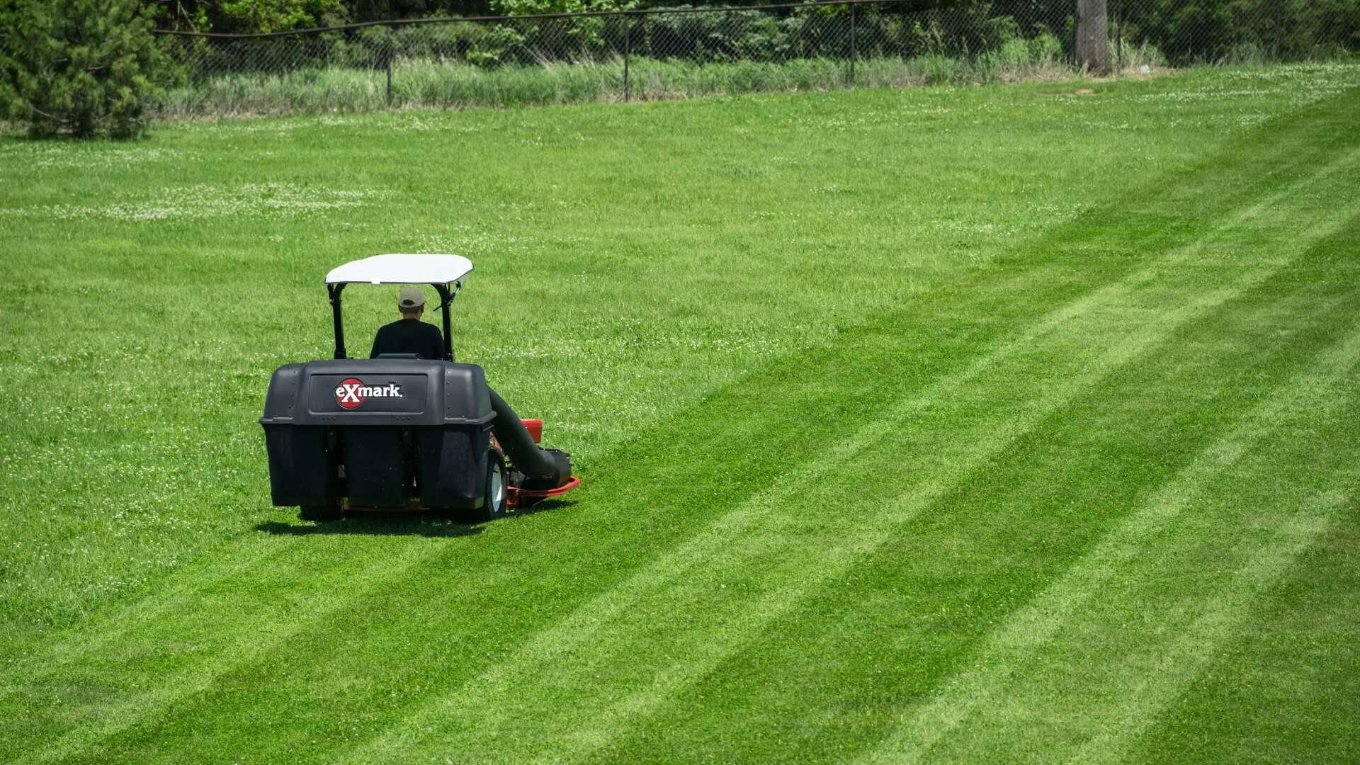 An Exmark mower micro mulching lawn clippings