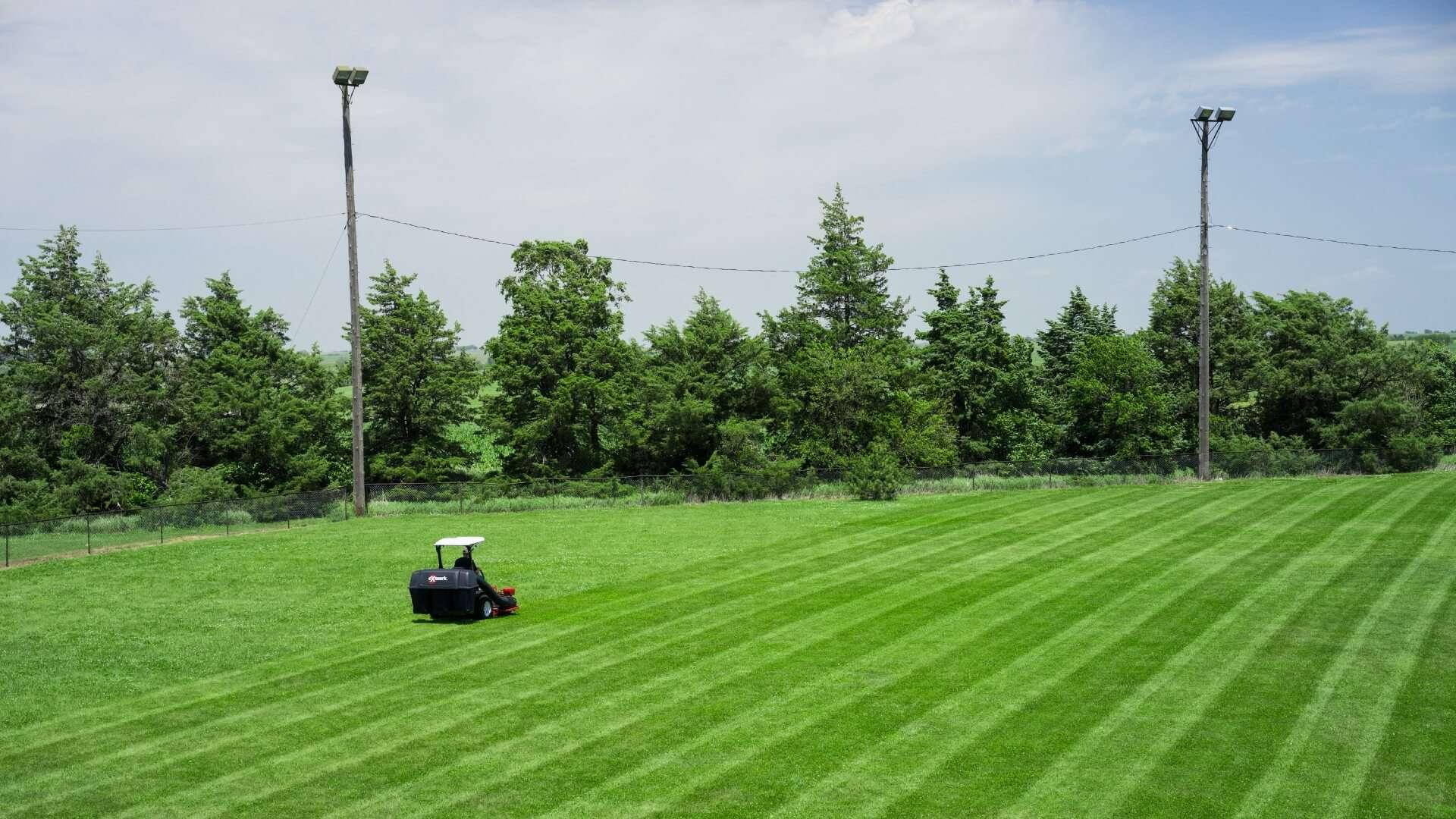 An Exmark mower striping a lawn