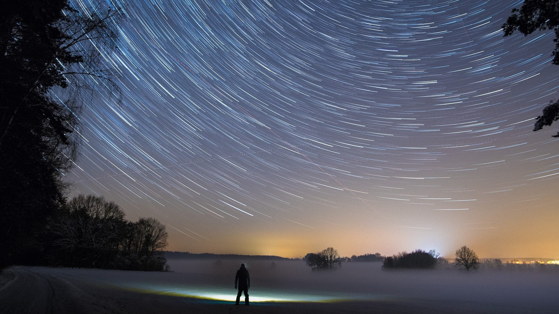 Image: Person looking up at the night sky