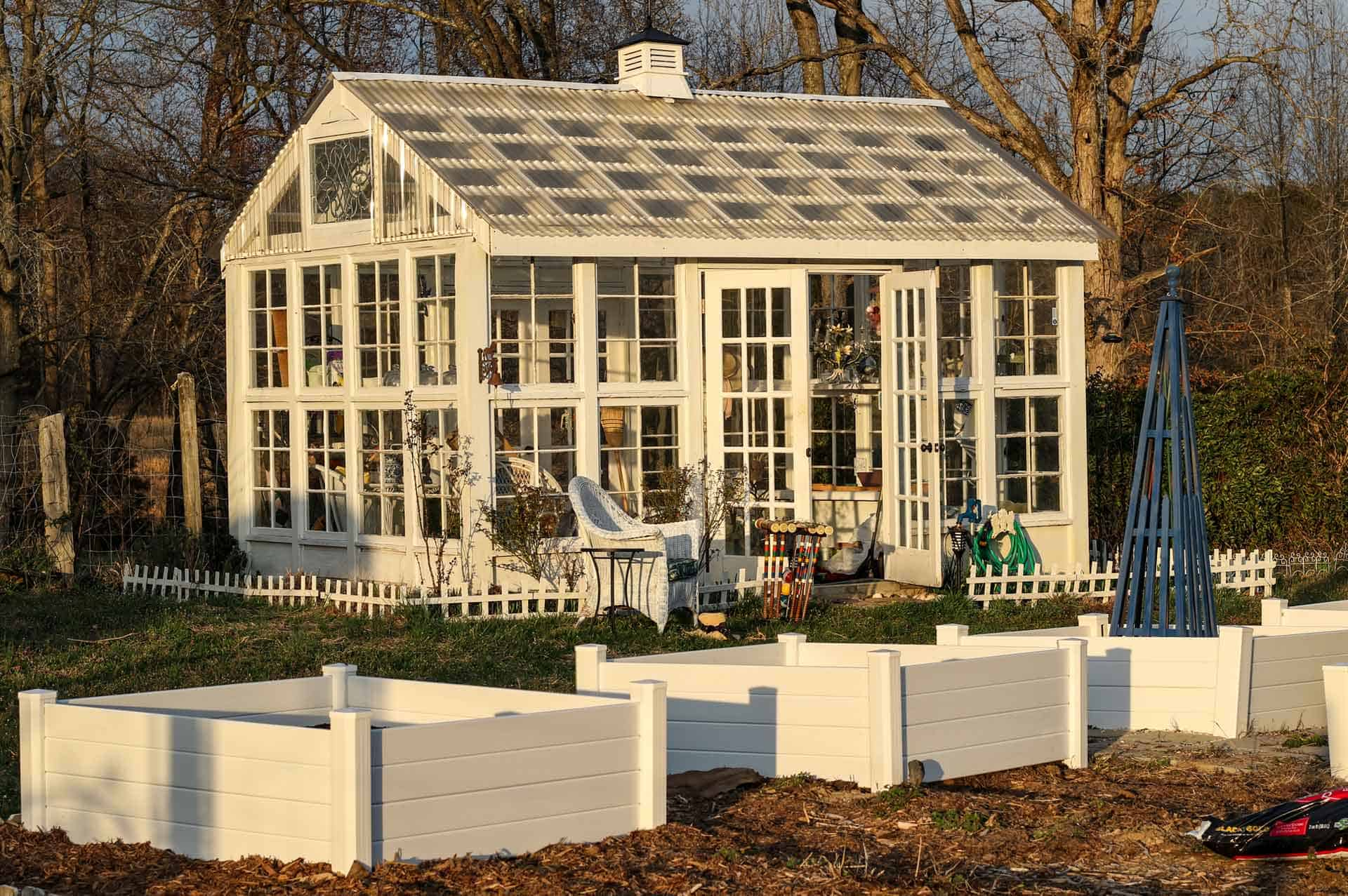 A freestanding greenhouse of individual panes of glass