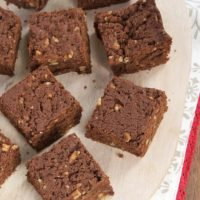 Chewy Graham Brownies on a pale wooden tray