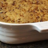 Tuaca adds a hint of citrus and vanilla to this Pecan Crusted Apple-Pear Crisp that features delicious fall fruits topped with a sweet, nutty topping.