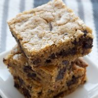 Salty Chocolate Chunk Blondies stacked on a white plate