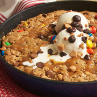 Quick to make and sure to please, this Monster Skillet Cookie is packed with all kinds of tasty things! - Bake or Break