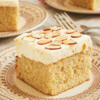 Brown Butter Almond Cake with Apricot Whipped Cream on a brown floral plate