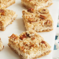 Pecan Cheesecake Bars served on a white plate