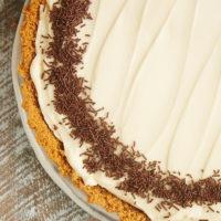 No-Bake Irish Cream Cheesecake garnished with chocolate sprinkles