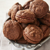 Double Chocolate Sandwich Cookies on a pewter tray