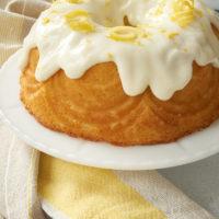 Lemon Bundt Cake on a white cake stand