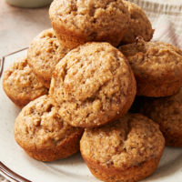 Cinnamon Pecan Muffins on a white and brown speckled plate