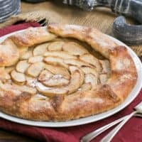 Maple Glazed Apple Galette on a white serving plate on a red napkin