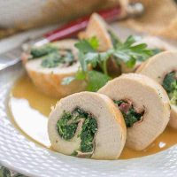 Chicken Spinach and Prosciutto Pinwheels - An elegant chicken dish that's easy to make at home!