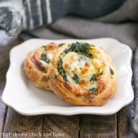 Two spinach feta pinwheels on a white plate