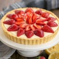 Strawberry Lemon Tart with lemon halves and whole strawberries