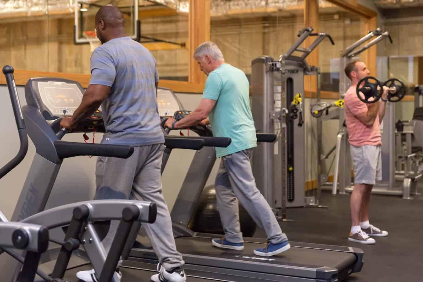 Men at Mountainside rehab's gym exercising to battle withdrawal symptoms.