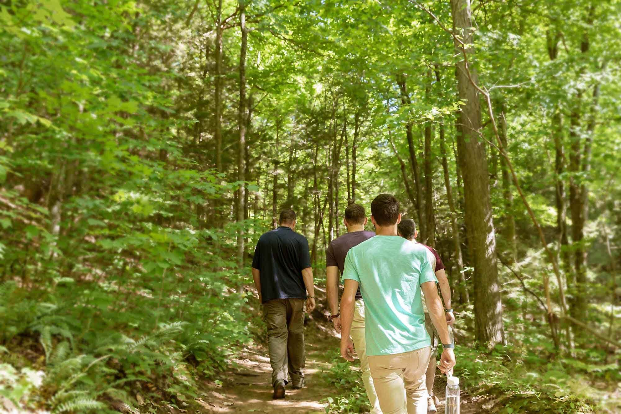 Recovering addicts hiking on Mountainside, CT property.