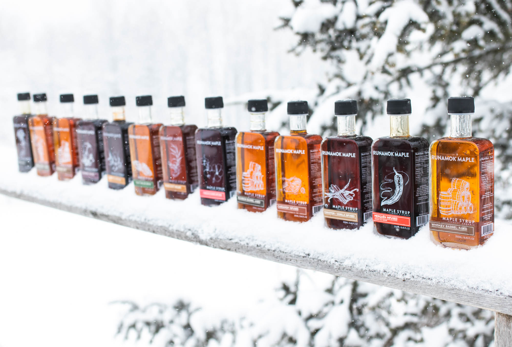 Runamok maple syrups lined up in snow