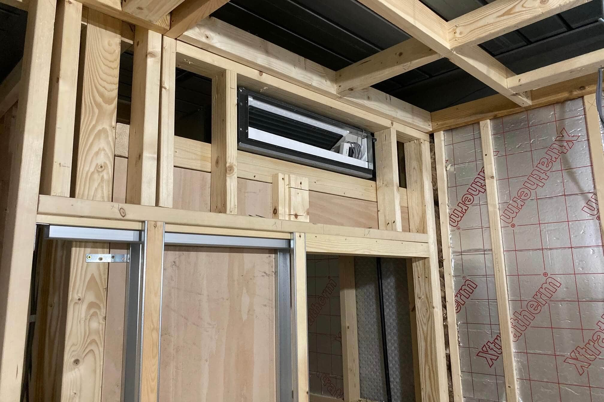 Chelsea developer property SubCool air con installation concealed unit above door building work