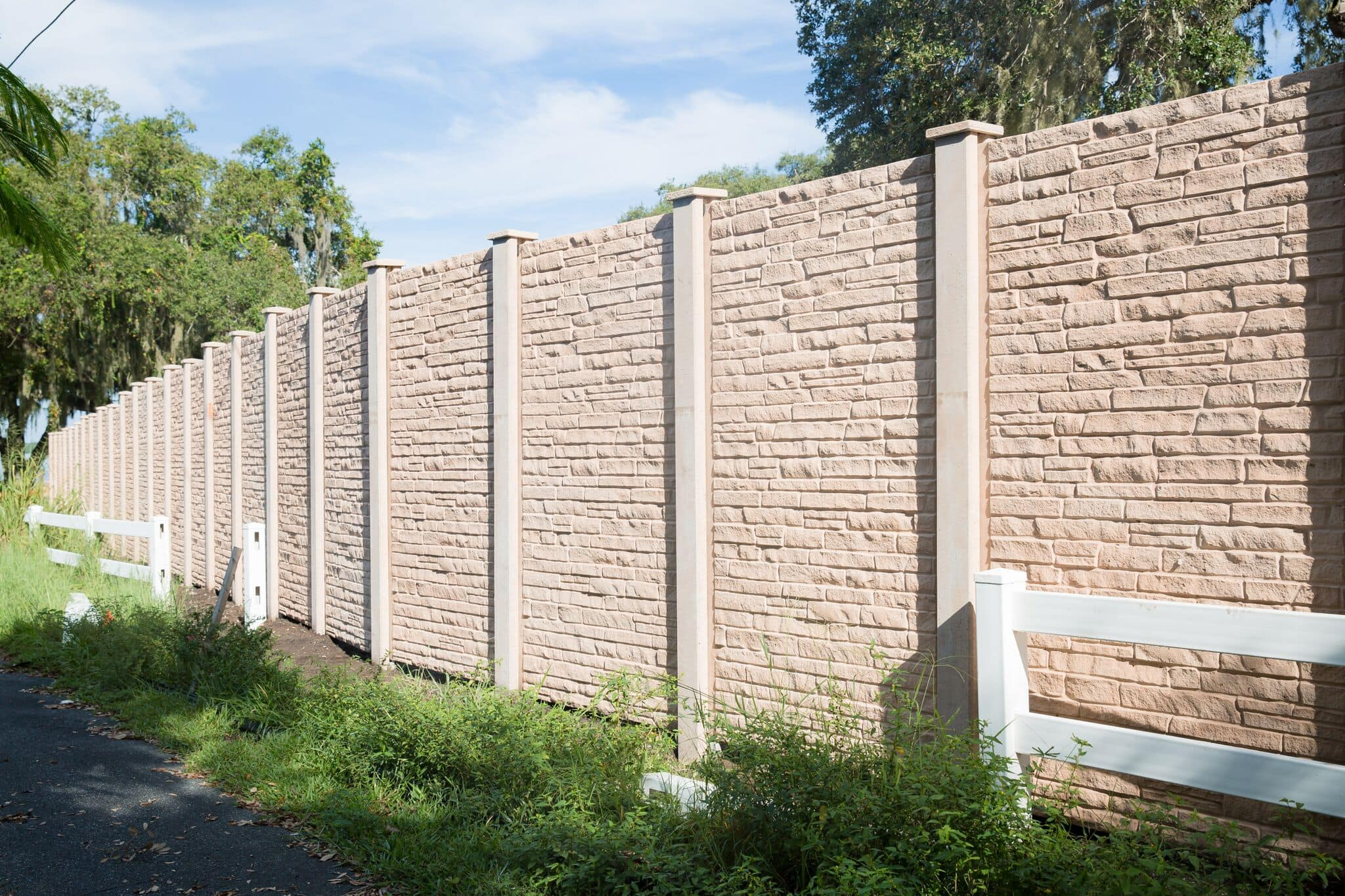 Permacast precast concrete fence in stone finish