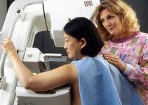 A Woman Receiving A Mammogram