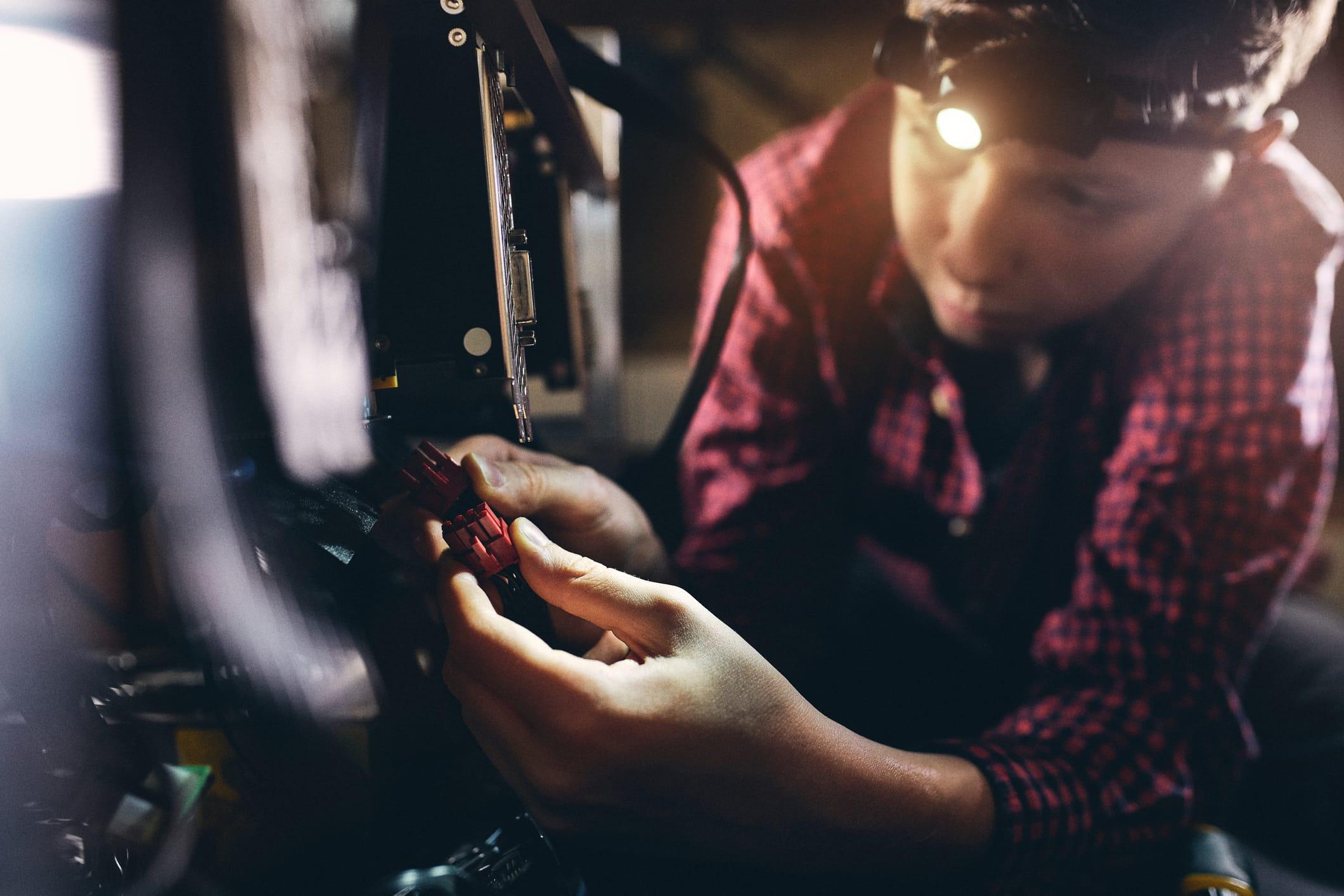 Teenager working on GPU mining rig