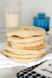 a stack of sourdough pita bread on a table