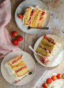 Three slices of strawberry and lemon curd cake. Flatlay.