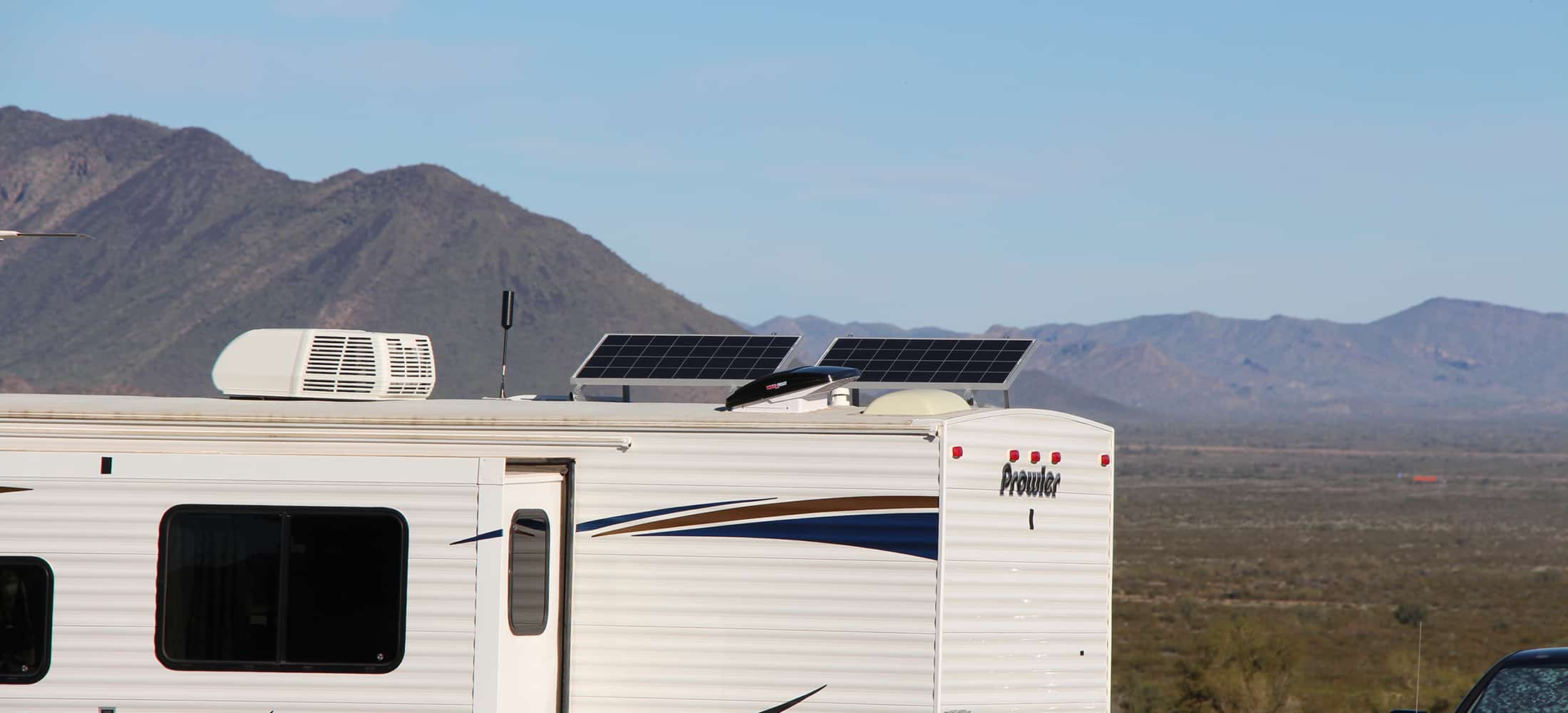Two 100 watt solar panels on travel trailer roof