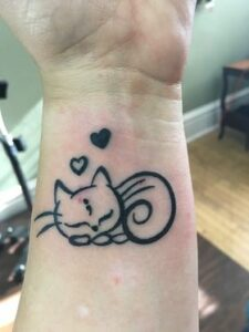 Image of cat tattoo on a forearm