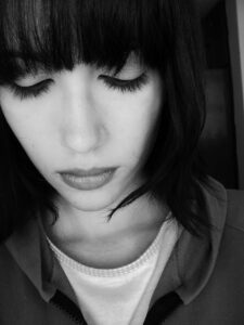 black and white of woman coping with grief and loss of parent