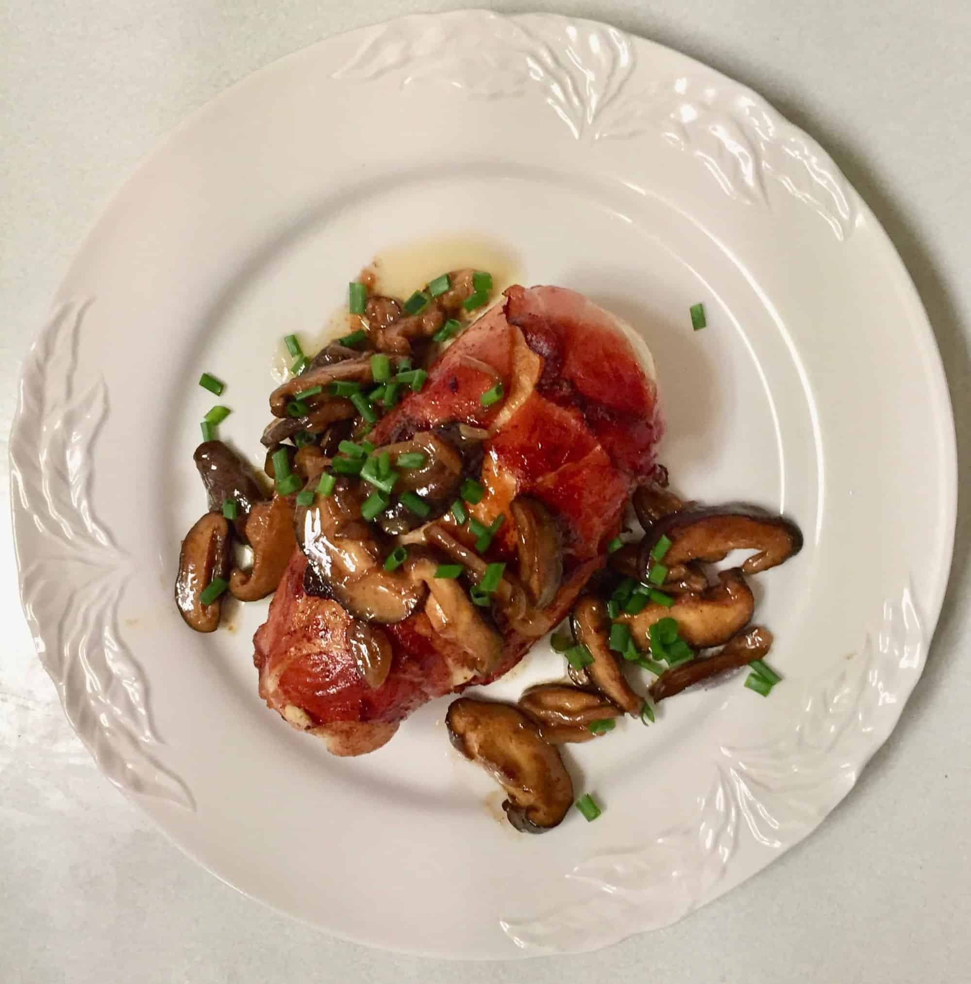 Prosciutto-wrapped Chicken Breasts stuffed with Black Truffle Goat Cheese, with Shiitake Mushrooms in a Marsala Sauce. Whew!