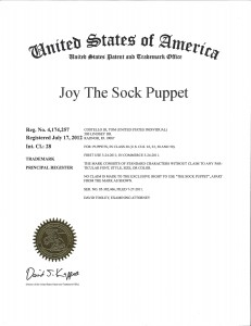Joy The Sock Puppet now has her own trademark! The Joy of Sox - new socks for the homeless.