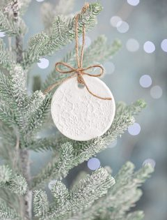 salt dough ornament on a christmas tree with lights