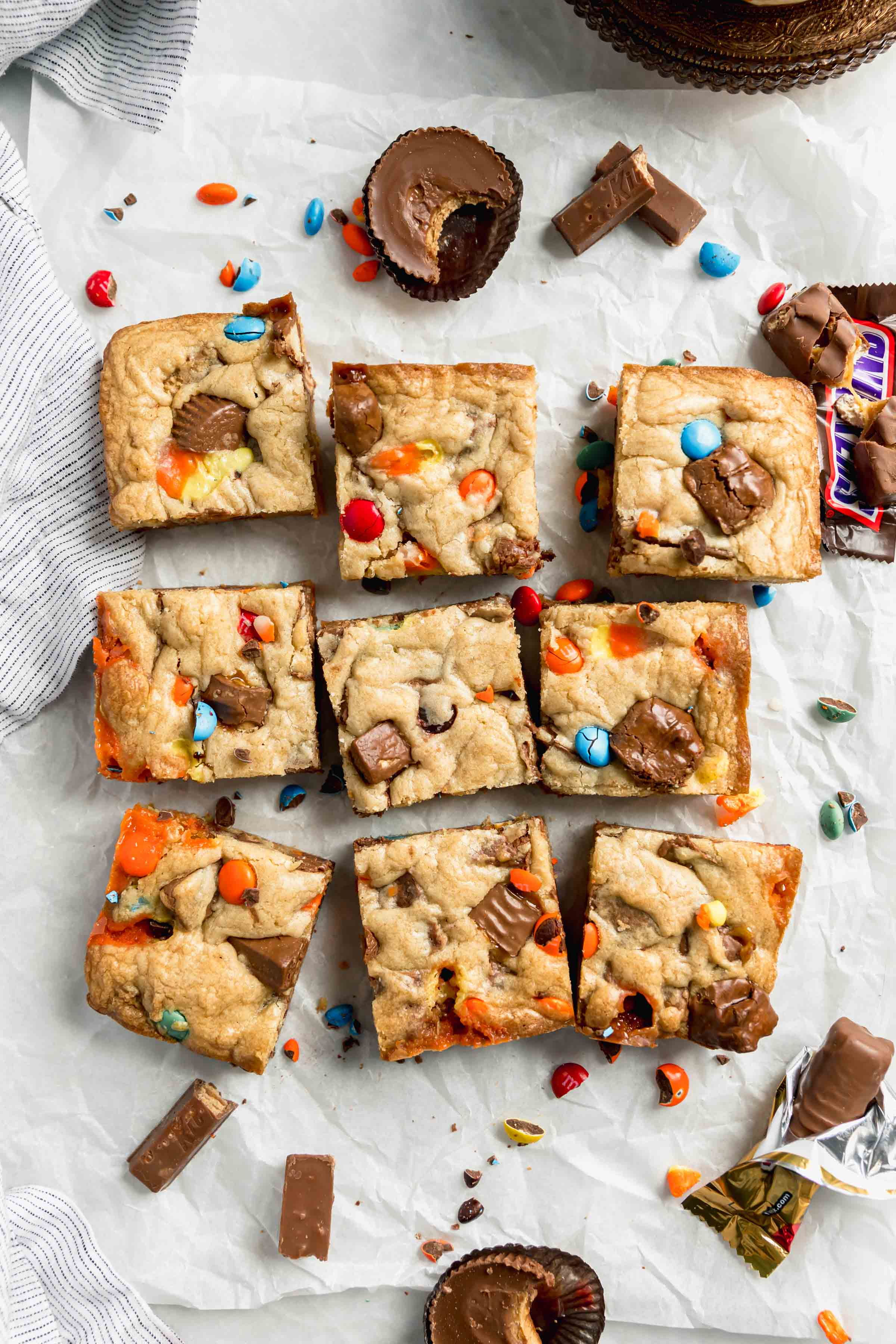 overhead shot of halloween candy cookie bars made with all that leftover candy